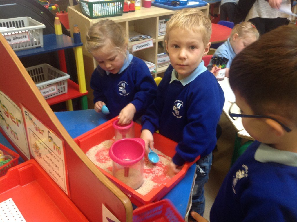 Working with the rice to develop our fine motor skills